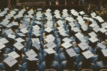 sea of graduates with lots of student debt