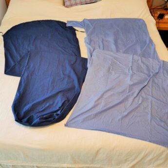Sleeping bag liners on bed
