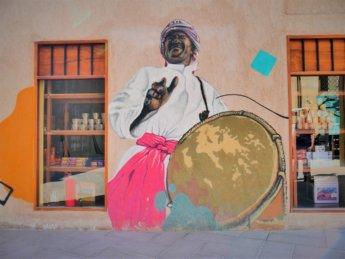 ajman heritage district street art man music