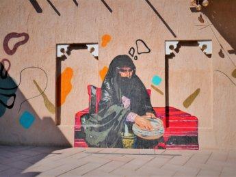 ajman heritage district street art woman