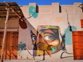 ajman heritage district street art woman eyes