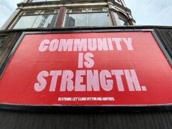 community is strength bullshit sign fake solidarity