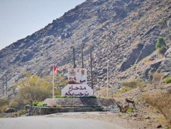 13 welcome to Madha Oman sign Sultan Qaboos Madha and Nahwa border exclave Oman UAE