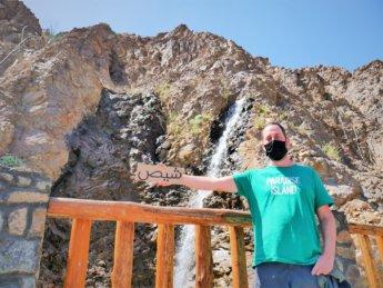 20 Jonas Shis Park Shees Chees UAE artificial waterfall hitchhiking sign