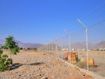 8 abandoned oil barrels Madha airfield Oman exclave UAE runway airport
