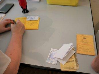 4 yellow card book yellow fever vaccination passport covid-19 sinopharm bishkek kyrgyzstan